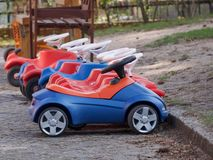 Childrens ride on plastic cars Royalty Free Stock Image