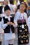Childrens from Romania in traditional costume. ROMANIA, TIMISOARA - JULY 7, 2016: Childrens from Romania in traditional costume, present at the international royalty free stock photo