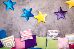 Childrens room pillows. Children's room decorative pillows on the wall Stock Images
