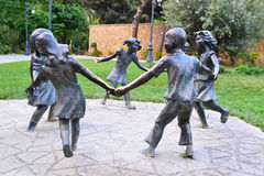 Childrens roundelay. Sculpture сhildrens roundelay in the park Stock Images