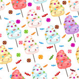Childrens seamless pattern funny cotton candy and candy. Stock Image