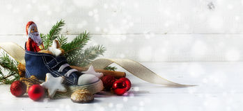 Childrens shoe filled with sweets, cookies and christmas decorat Stock Images