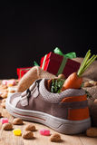 Childrens shoe and pepernoten for Sinterklaas Stock Photos