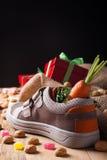 Childrens shoe and pepernoten for Sinterklaas Stock Photos