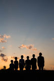 Childrens are standing on the field with sunset background Royalty Free Stock Photography