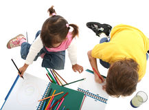 Childrens students with crayons. Childrens students in your home, wtih crayons over white Royalty Free Stock Photos