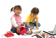 Childrens students with crayons and computer. Childrens students in your home, wtih crayons, pencil and computer Royalty Free Stock Photography
