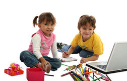 Childrens students with crayons and computer. Childrens students in your home, wtih crayons, pencil and computer over white Stock Photo