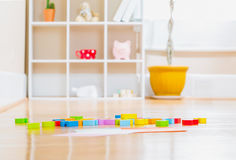 Childrens toy blocks inside a home. Childrens toy wood blocks inside a home Royalty Free Stock Image