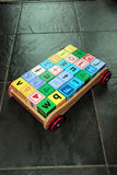 Childrens toy cart and letter play blocks Royalty Free Stock Image