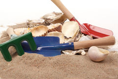 Childrens toy garden tools and  on the beach Royalty Free Stock Image
