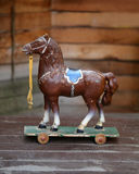 Childrens toy vintage horse. On wheels photographed in close-up Royalty Free Stock Photography