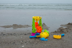 Childrens toys at the beach Stock Photo