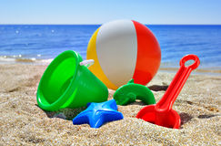 Childrens toys on the beach Stock Images