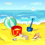 Childrens toys on the beach Royalty Free Stock Photo