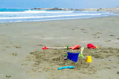 Childrens toys laying on the beach stock image