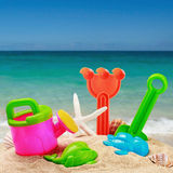 Childrens toys in the sand Stock Photo
