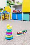 Childrens toys scattered on the floor Royalty Free Stock Photos