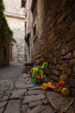 Childrens toys on streets in Groznjan, Istria. A street with childrens toys in Groznjan, Istria, Croatia Royalty Free Stock Photography