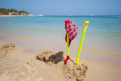 Childrens toys on a tropical beach Royalty Free Stock Photos