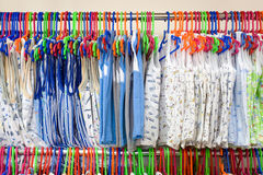 Childrens undershirts. On clothes hangers at a store royalty free stock photos