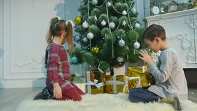 Childrens unpack surprise for Christmas. The concept of holidays stock video