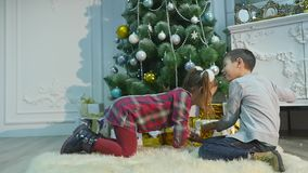 Childrens unpack surprise for Christmas. The concept of holidays stock footage