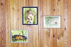 Childrens watercolors arts hang on wall