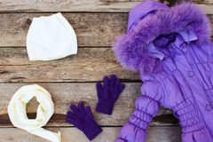 Childrens winter clothes: warm jacket, hat, scarf, gloves Stock Photography
