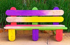 Childrens wooden handpainted bench stock photos