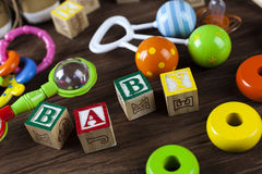 Childrens World toy on a wooden background. Stock Photos