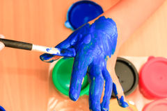 childrent painting color on her hand Royalty Free Stock Photo