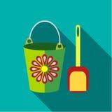 Childrentoy pail z łopatą w niebieskozielonym tle Obraz Royalty Free
