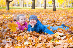 Childs in autumn park Stock Images