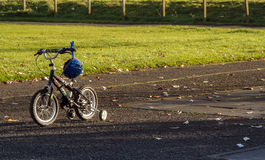 Childs Bike in Autumn Park Royalty Free Stock Photos