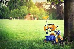 Child bike under tree Stock Photography