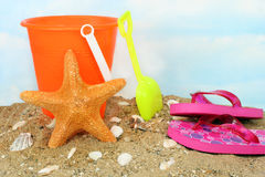 Childs bucket with a Jungle starfish Royalty Free Stock Image