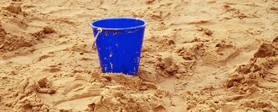 Childs bucket on sand Royalty Free Stock Photo