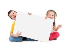 Childs con el papel en blanco Foto de archivo libre de regalías
