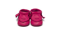 Childs dark pink booties on a white background Stock Photos