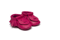 Childs dark pink booties on a white background Royalty Free Stock Photo