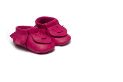 Childs dark pink booties on a white background Stock Image