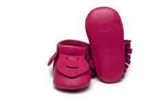 Childs dark pink booties on a white background Royalty Free Stock Image