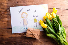 Childs drawing of her mother, yellow tulips, little gift Stock Photo