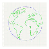 Childs drawing of the planet Earth on a notepad le Stock Photography