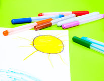 Childs drawing of sun and color pens Royalty Free Stock Photo