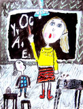 Childs drawing. Woman teacher at blackboard in classroom with girl explaining the lesson. Royalty Free Stock Photos