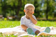 Sweet little kid looking at the sky Stock Photo