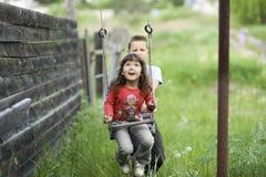 Childs ed oscillazione Fotografie Stock