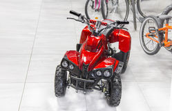 Childs electric red four wheel motorcycle Stock Image
